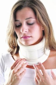 Painful woman wearing cervical collar